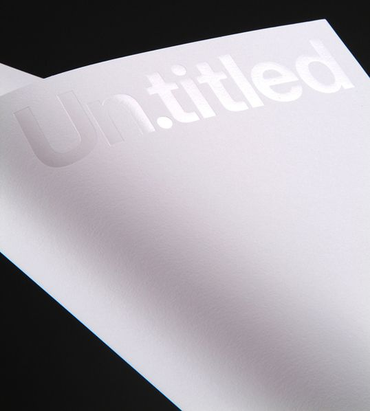 """""""New stationery for Un.titled. Printed on GFSmith papers. Business card: Clear and matte silver foil on Graphite Plike, red foil onto cool grey Colourplan, with red Colourplan sandwiched in the middle."""