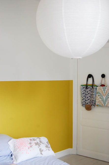 Our bedroom Color block bottom half of the wall behind the bed and need a big hanging rice paper lantern in the corner.