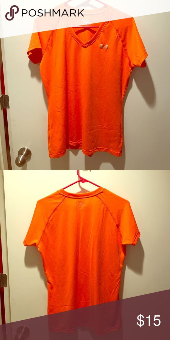 Orange Under Armour HeatGear Shirt Short-sleeve semi-fitted bright orange Under Armour workout shirt. Heat gear, meaning it's a very light and breathable material good for keeping you cool while sweating. In like new condition. Under Armour Tops Muscle Tees