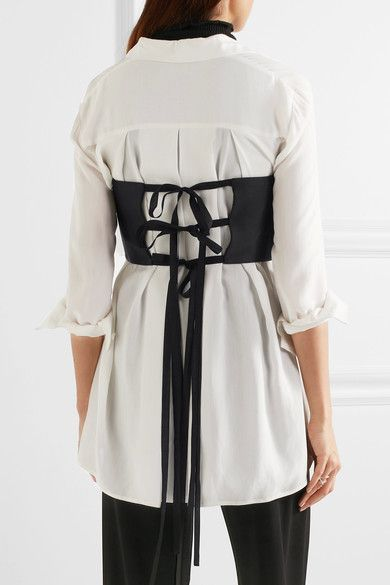 Lace-up corset top over white shirt