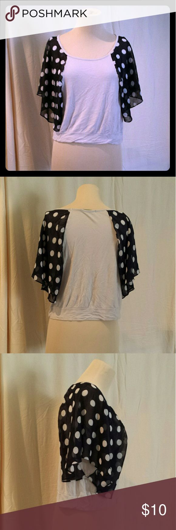 Polka Dot Flowy Dolman Top The grey part is very stretchy, and the navy is very flowy and partially see through.   Modeled on a medium mannequin,  so on a small it would be even more flowy!   Length: 20in Pit to pit laying flat: 20in  Waist laying flat: 20in  Bottom laying flat: 20in   #polkadots #dots #grey #gray #blue #white #blueandwhite #Dolman #stretchy #comfy #spring #summer #loose #soft #airy #flowy #anytime #seethrough #navy #navyblue #chiffon #knit #Blouse Inspired Tops Blouses