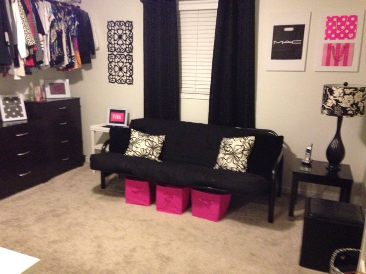 Changed a spare bedroom into a walk in closet / makeup room / ladies  lounge! Huge bar with exposed hanging area. Futon for lounging.