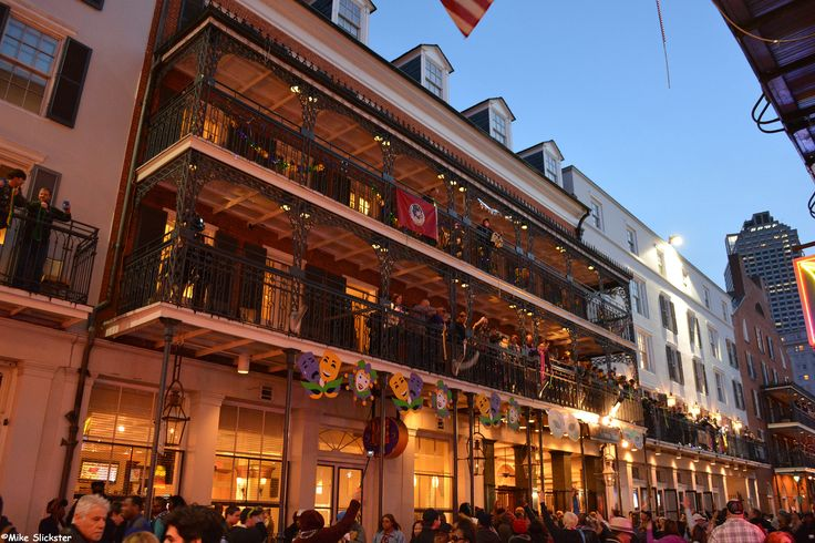 More revelers on the balconies of the magnanimous Royal Sonesta Hotel on Bourbon Street, Lundi Gras 2014