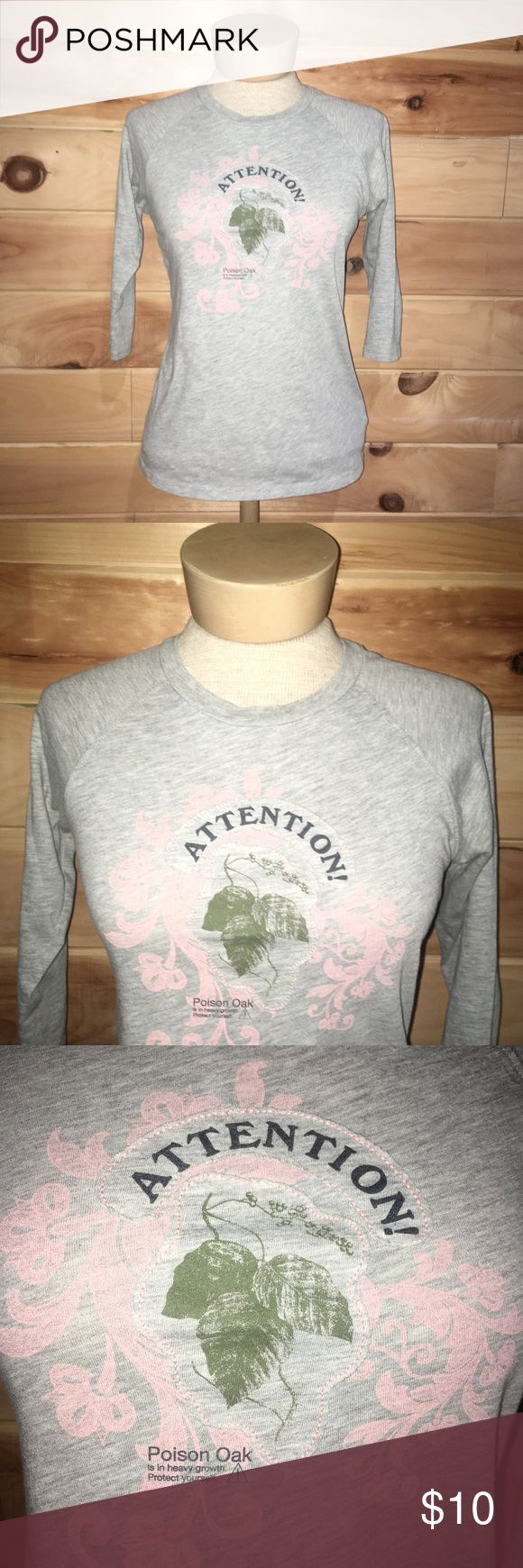 """Old Navy Attention Poison Oak 3/4 Sleeve Shirt Old Navy attention poison oak 3/4 sleeve shirt. Size small. Gray crew neck shirt. Front has a picture of a poison oak leave and says 'attention' in big letters towards the top. Below the leaf it says 'poison oak is in heavy growth, protect yourself'. Also has a little pink design behind the leaf. There's a very small stain below the pink design but it isn't super noticeable. 65% cotton and 35% polyester. 32"""" bust. 23.5"""" length. 14"""" sleeves. No…"""