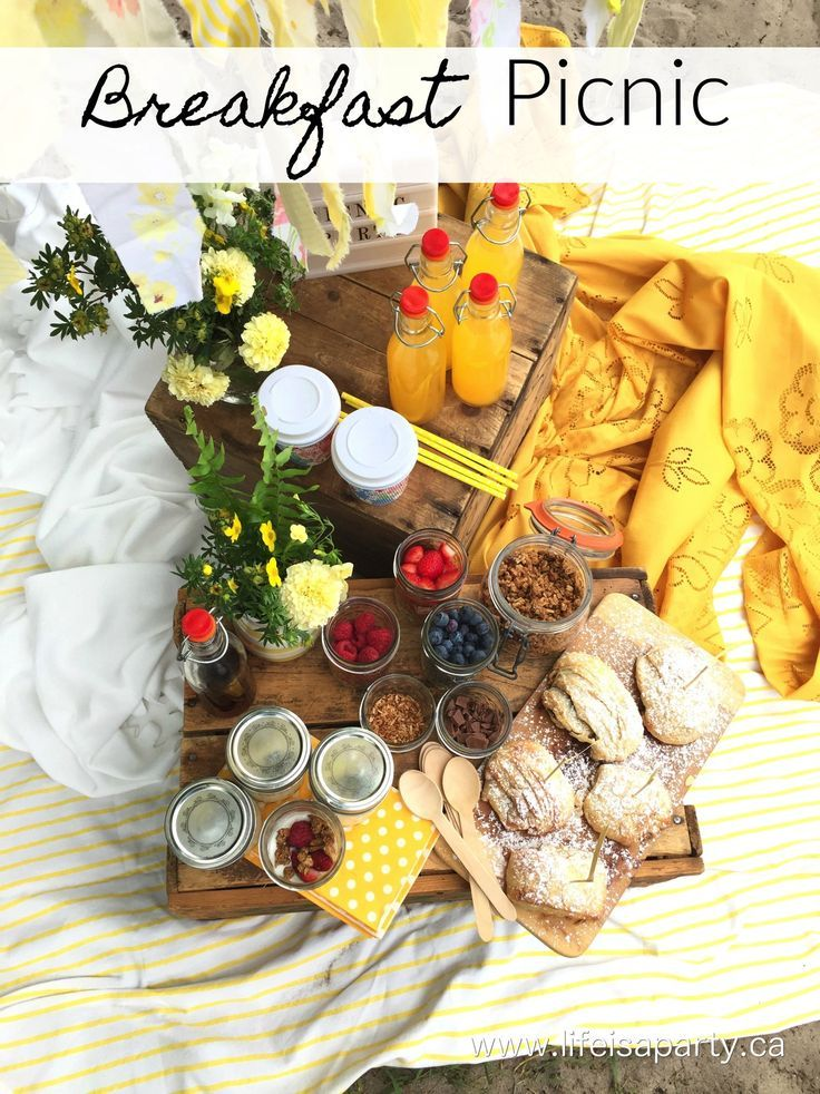 A beautiful breakfast picnic with yellow decor and links to all the recipes including homemade croissants and a yogurt parfait bar!