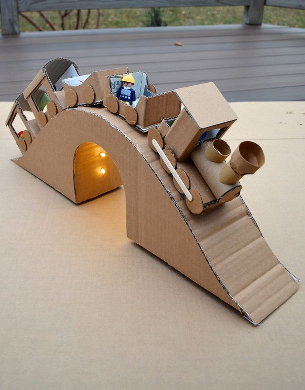 Train set big enough for play characters to go insisde. IKEA STRALA lights. Cardboard, Lolly sticks + hot glue