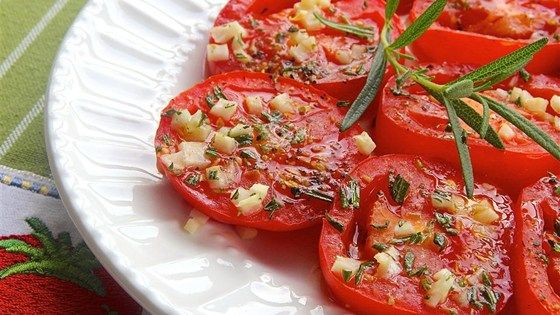 Baked tomato slices seasoned with rosemary and garlic make colorful and tasty pizza toppers.