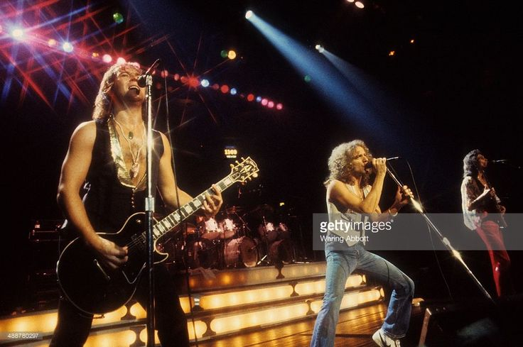 British guitarist Mick Jones, American vocalist Lou Gramm, and American bassist Ed Gagliardi of the British-American rock group Foreigner performing live at New Haven Veteran's Coliseum on January 1, 1978 in New Haven, Connecticut.