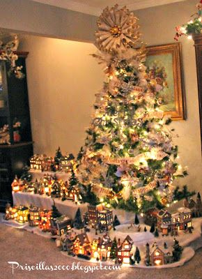 Priscillas: Christmas Village 2013 - I like the idea of setting up a tree with the village below (reminds me of the neopolitan creche display at the Met in NYC).  Using a small artificial tree this would be manageable - then a real tree elsewhere for the scent.