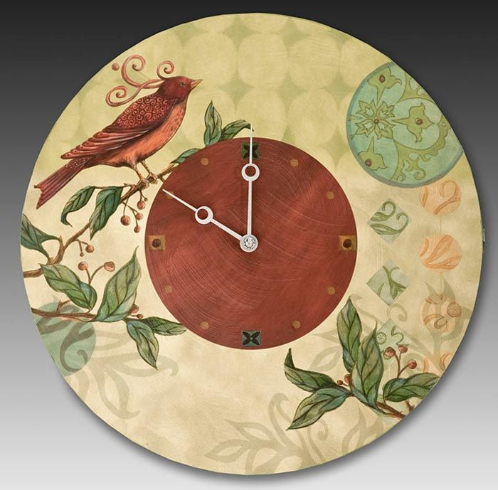 Janna Ugone and Justin Thomas creates this artistic, Round Wall Clock in Birdscape. The edge of each piece is hand painted in a beautiful, complimentary color. Each clock is signed, dated and hallmark