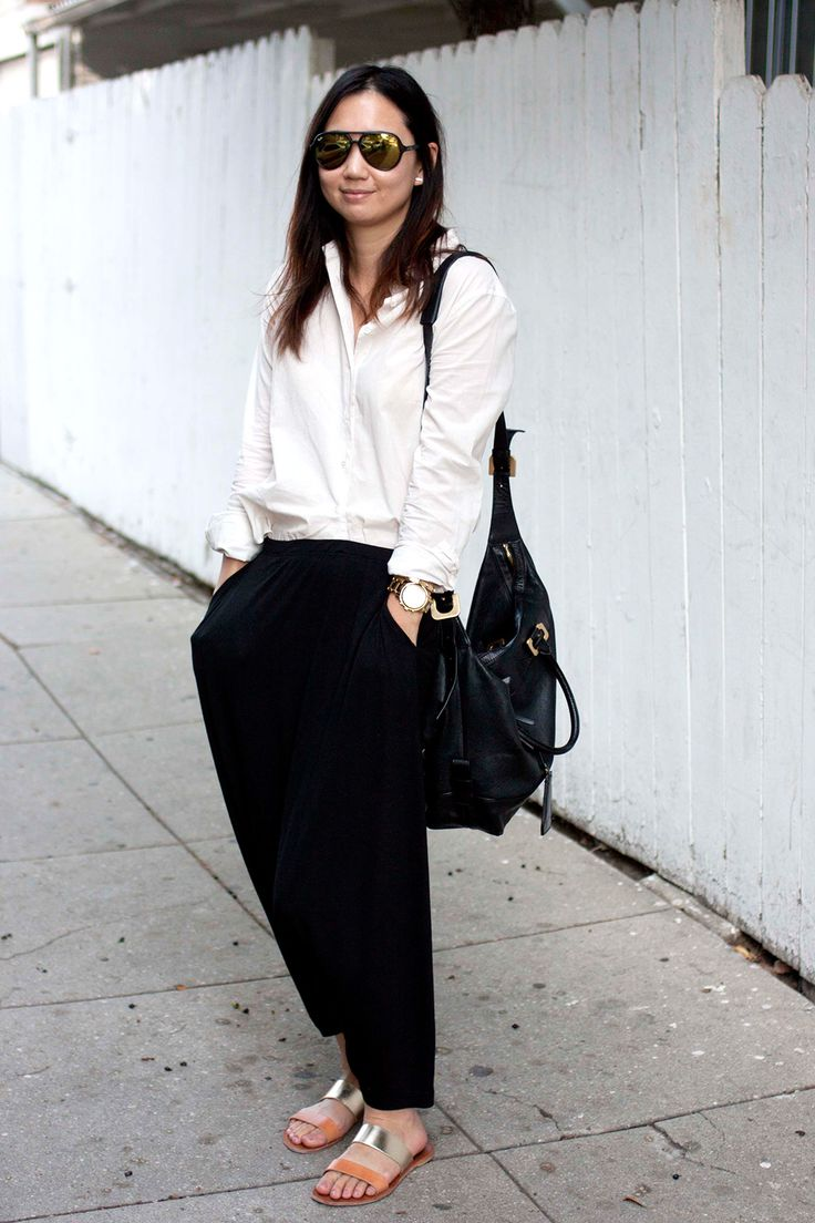 Andrea Choe, physician-scientist, ATM top, Eileen Fisher pants, Joie sandals, DVF bag.