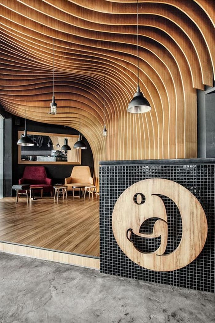 Wavy timber slats delivering a cave like feel new six for Interior design 2 year degree