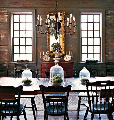 Old World Elegance Using a dark palette throughout this spacious dining room makes it feel more intimate. The dark-washed wood panels add a rustic                          backdrop to the elegant dining room accessories.