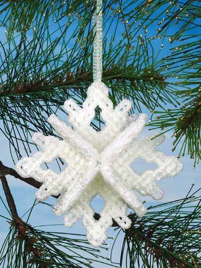Snowflake Ornaments Plastic Canvas Pattern Download from e-PatternsCentral.com -- Stitch a sparkling snowflake mobile and dimensional ornament for your Christmas tree.