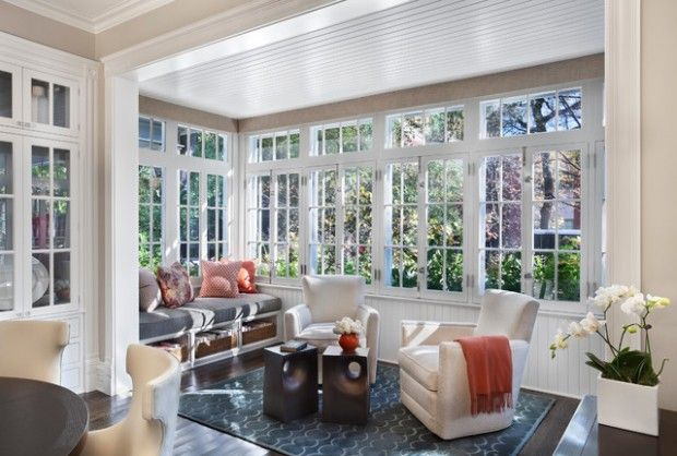 Beautiful sunroom addition off the kitchen with hardwood floors, bright windows and wanes coting ceiling Coastal Va Magazine's Best Kitchen & Bathroom Remodeler #dogoodwork www.jimhicks.com