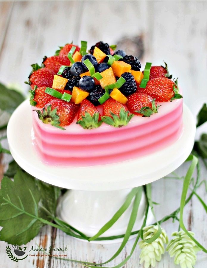Make this simple refreshing fruity agar agar jelly with some fresh strawberries with black berries, blueberries and mango on top. .