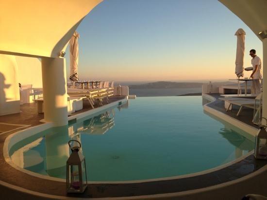 CHROMATA Hotel Santorini | pool area at sunset