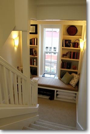 Turning wasted space on a staircase into storage and an amazing little reading nook