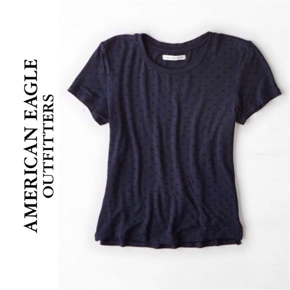 AEO Navy Blue Polka Dot Baby T Tee Shirt Brand: American Eagle Outfitters Size: Large  This shirt is in good condition. It is navy blue and features black polka dots throughout. It is short-sleeved and slightly cropped with short slits on the sides. American Eagle Outfitters Tops Tees - Short Sleeve