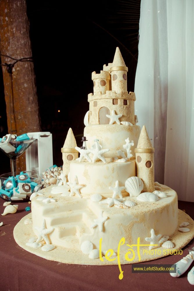 Don't know about for a wedding but this is an awesome sand castle cake