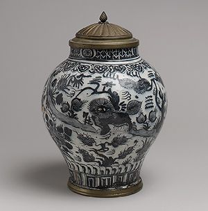 Jar with lion and landscape elements, Safavid period (1501–1722), first half of 18th century  Iran  Stonepaste; painted under transparent glaze; brass