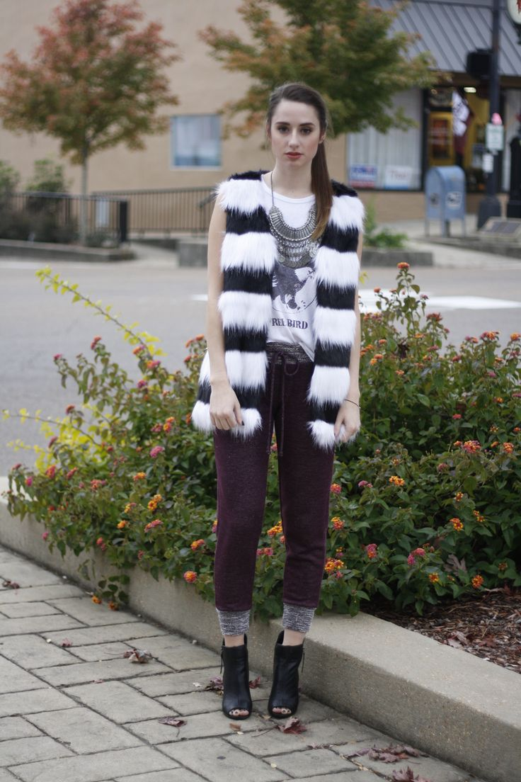 Messy ponytail tutorial & how to style a fur vest. Stripe Faux Fur Vest, $54; JF Free Bird Tee, $40; Maroon Joggers, $32.50; Dorado Boot in Beige, $34 available at stylerevel.com