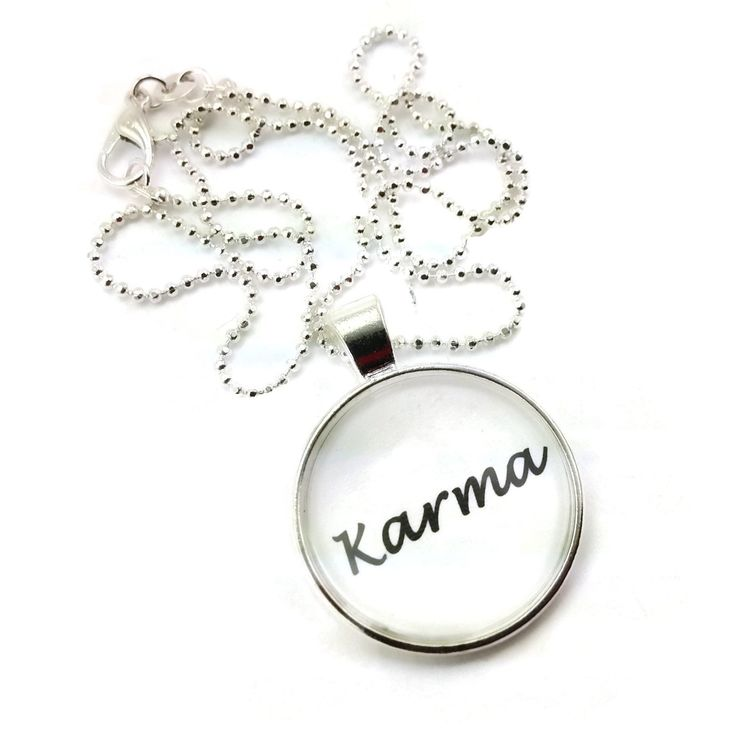 A great simple design, that just states a simple word, 'Karma', simple but to the point charm style necklace.