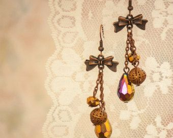 Glimmering Teardrop Dangle Earrings with Copper Bow