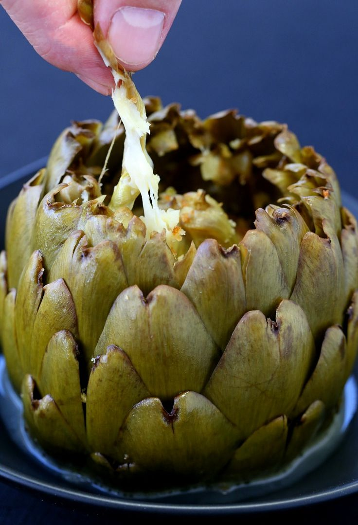 Stuffed Artichokes with Garlic and Fontinella are a tradition in my family. And we don't wait for the Holidays to make them, we make them as much as we can!