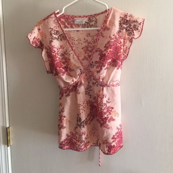Charolette rouse pink top size medium Adorable charolette rouse pink, mason and brown top. This too has tie in back and is v neck with keyhole in front... Adorable! Charlotte Russe Tops Blouses