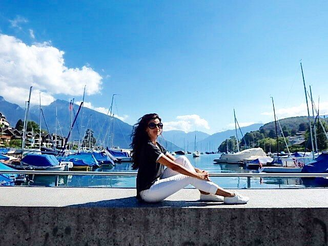 Nestled between hills and vineyards and dominated by a magnificent castle, #Spiez on Lake #Thun is an inviting destination for those visiting #Switzerland. I loved this little town . Wearing @anywhereapparel transfer top - travel light, discover more!