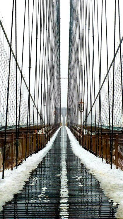 A non-optical illusion of one of the world's most iconic bridges, the Brooklyn Bridge in New York City /// #travel #wanderlust #snow