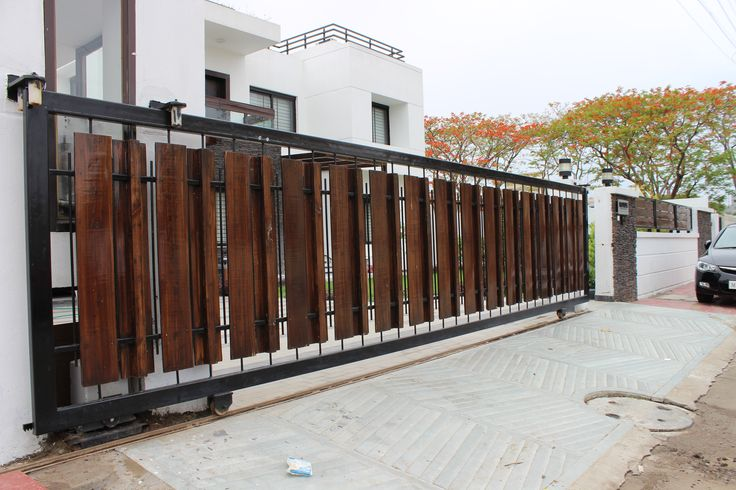 Stainless steel sliding gate designs navodaya steels - Sliding main gate design for home ...