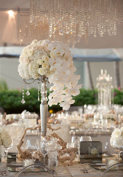 a modern tall design with cascading phalaenopsis orchids