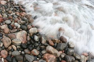 Search for Lake Superior agates in surrounding areas with many pebbles and rocks.