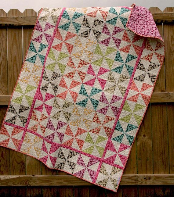 Like the thin sashing strips with the same blocks in the border and who knew all pinwheels would look nice together?