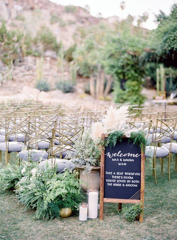 Create an inviting scene as guests arrive at the ceremony. In addition to a sweet sign, add a variety of lush potted ferns and grasses, as well as glowing candles, to greet guests as they take their seats.