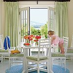 Nice breakfast nook with a view. Liking the mix of greens and blues with neutrals.