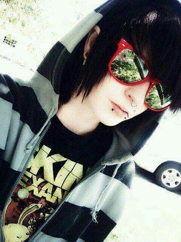 Emo boy wearing an Asking Alexandria t-shirt with sunglasses and piercings.