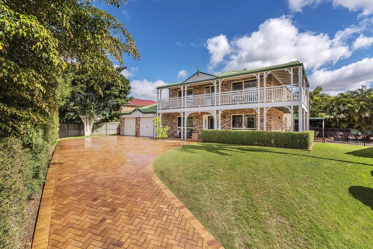 WISHART 2 Lexington Place...Elegant and commanding, this north-east facing brick Queenslander on 833m2 is enhanced by sweeping verandahs that captures mesmerising green outlooks.