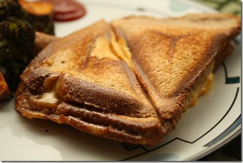 Triangle grilled cheese sandwiches (toasts) - preferably Schulstad 3 grain loaf + Hochland cream cheese slices
