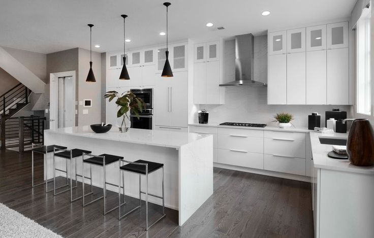 Contemporary luxury white kitchen with black light fixtures in EYA's Bradley model at the Brownstones at Chevy Chase Lake. Click pin to learn more. Luxury Townhomes | Chevy Chase, MD | Washington, D.C. Metro Area