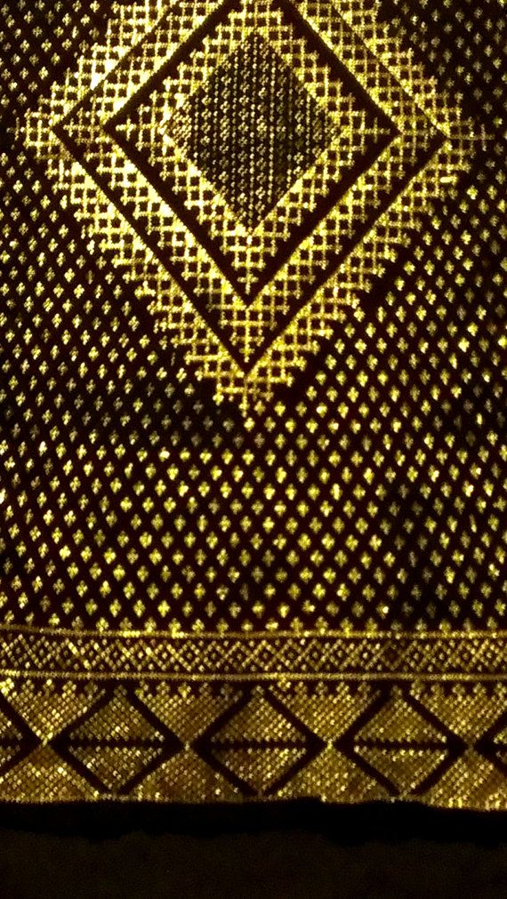Rare GOLD 1920s Assuit shawl. A rarely seen gold on black Assuit shawl. Comprising of 3 large diamond motifs, each containing decreasing