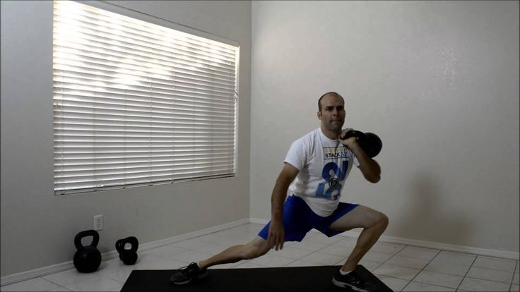 Kettlebell Rack Lateral Lunge.  Visit http://strength.stack52.com/periodic-table-of-kettlebell-exercises/ for 100 + free kettlebell exercises!