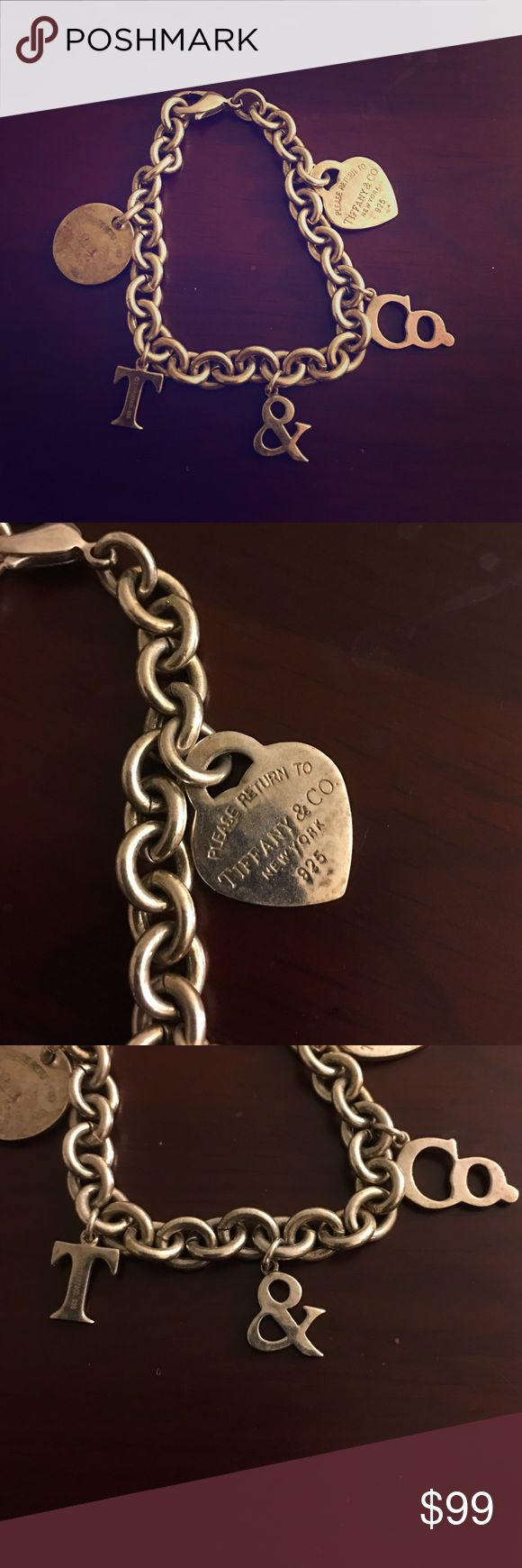 Rare Vintage Tiffany & Co. Charm Bracelet 925 Sterling.  Gorgeous Quality piece.  Was told it's not authentic T&Co.  but still a great piece to have regardless  Tiffany & Co. Jewelry Bracelets