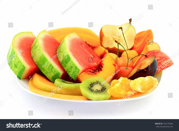 Fruits platter served as healthy breakfast in white porcelain dish (plate) over white background.