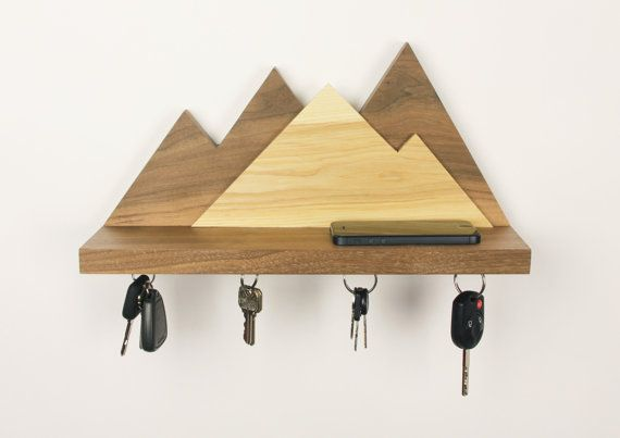 This wonderful floating wall mounted shelf and key ring holder designed by grain is a great way to keep your essentials organized. Four