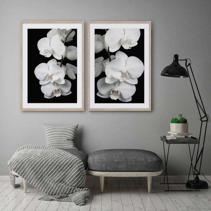 Combining a dramatic black background, and muted tones, the softfeminine lines of theorchid are a contemporary ode tothe raffles style whileradiating a timeless elegance.  Designed exclusively by Wall Style Studio. [ORCHID BLISS 1 & 2]