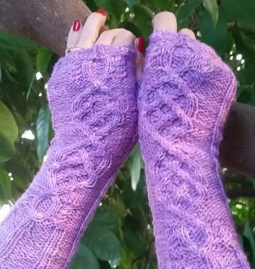 Inspired by the TV Series Outlander, Celtic Desire Fingerless Glove pattern is a delight to knit up.