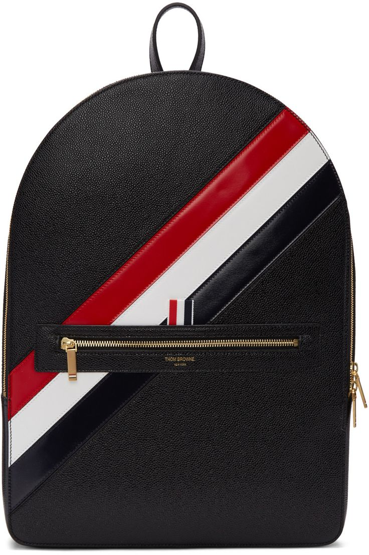 Structured 'pebble grain' calfskin backpack in black. Carry handle at top. Twin adjustable shoulder straps. Signature tricolor leather stripes, logo stamp in gold-tone, zippered pocket, and tricolor grosgrain pull-tab at face. Two-way zip closure. Logo patch and zippered pocket at interior. Textile lining featuring signature tricolor stripe. Gold-tone hardware. Tonal stitching. Approx. 13